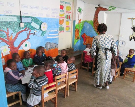 Kidogo children learning how to read and write