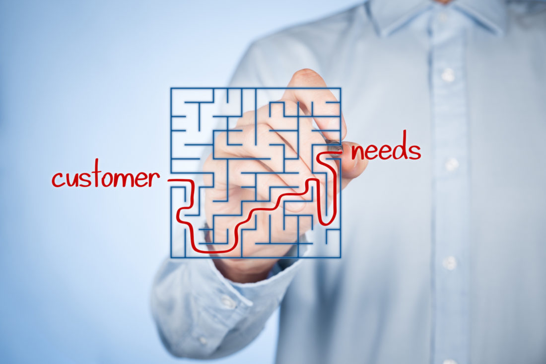 man drawing through a maze to show finding customer needs