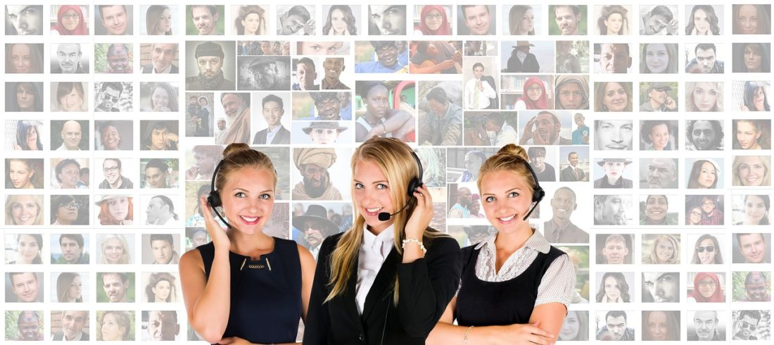 three women with headsets showing customer relations